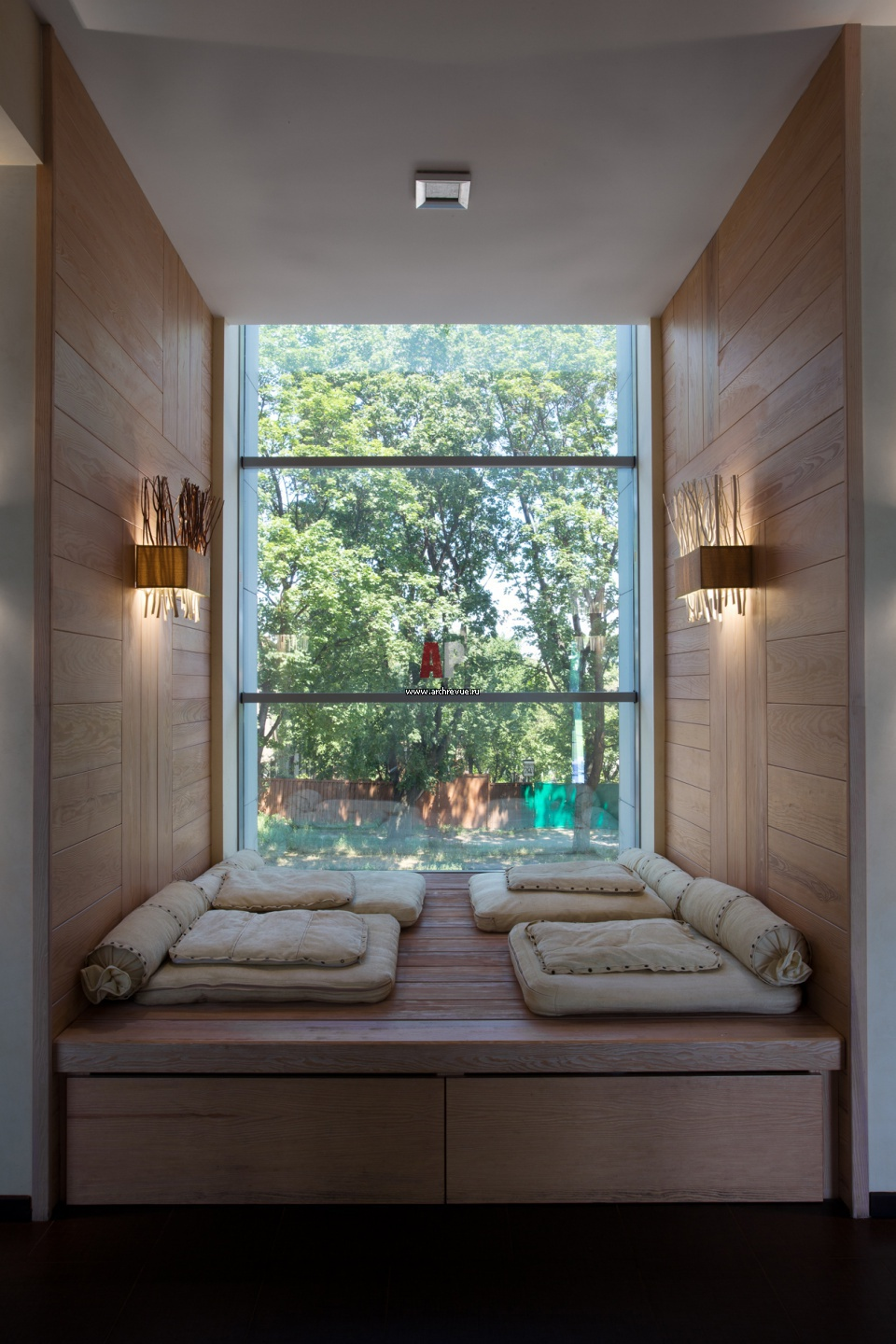 Interior. interesting reading nook window with beige fabric .