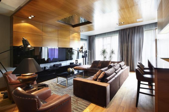 Фото интерьера гостиной квартиры в современном стиле.